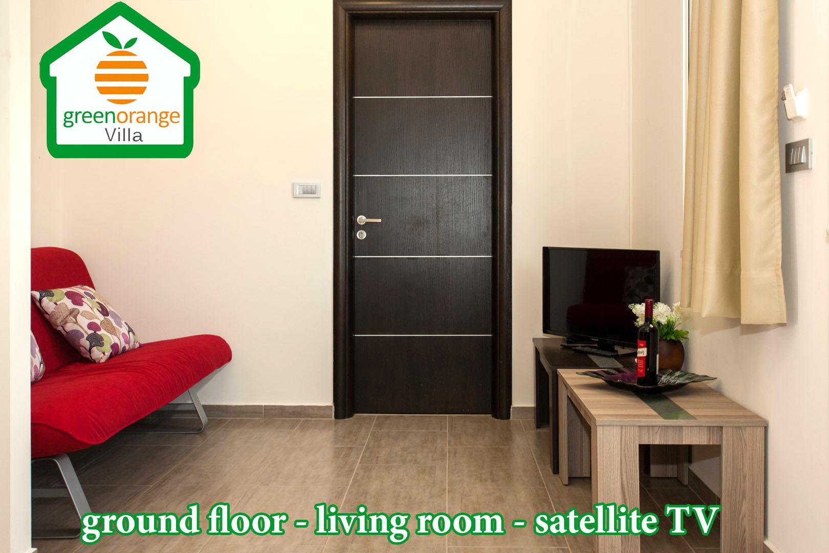 living-room-satellite-tv-green-orange-villa